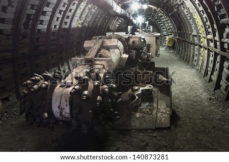 Coal mining machine with rotating cutting drums - stock photo