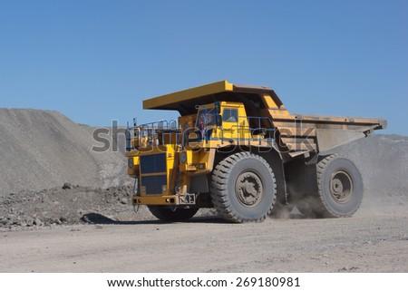 Coal mining. The truck transporting coal. - stock photo