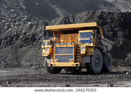 Coal mining. Yellow mining truck. - stock photo