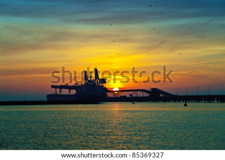 Coal pier at sunrise in port of Gdansk, Poland. - stock photo