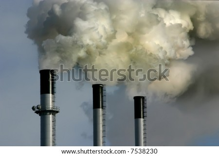 Coal plant emitting pollution. Burning coal is a leading cause of smog, acid rain, global warming, and air toxics. - stock photo