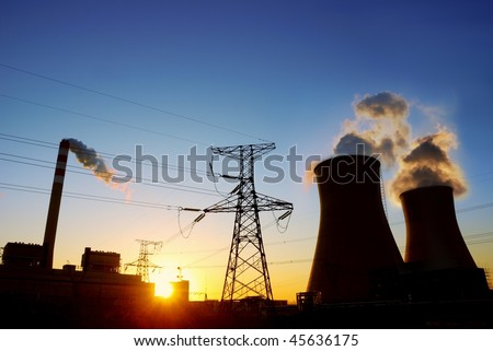 Coal power plant at sunrise - stock photo