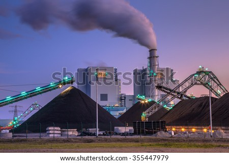 Coal power plant play a vital role in electricity generation worldwide. Altough modern plants are much more efficient than before, it is not a clean form of electricity. - stock photo