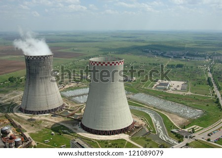 Coal power plant polluting the planet, several thin and several thick chimneys smoking towards the sky - stock photo