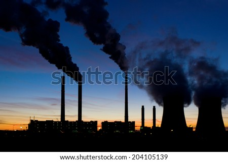 Coal power plant under evening sky