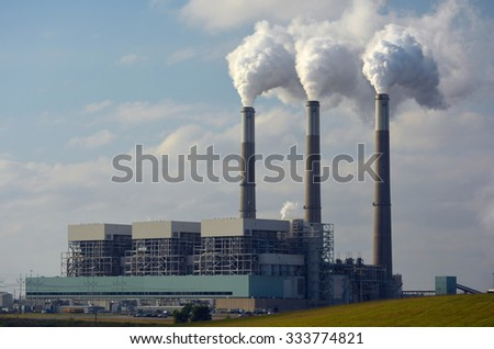 Coal Power Plant with Carbon Dioxide Coming from Smokestacks. - stock photo