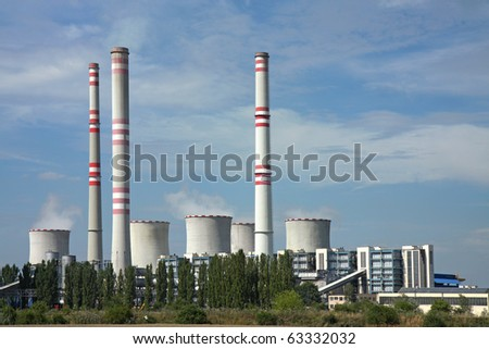 coal power plant with chimney and cooling towers - stock photo