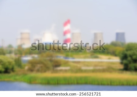 Coal power plant with chimney and cooling towers.Specially blurred photo - stock photo