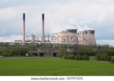 coal power plant with cooling towers and high chimneys