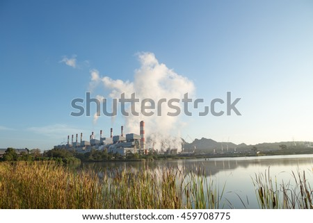 Coal power plant with steam pouring out of the stack in morning, Mae Moh Power Plant, Lampang, Thailand