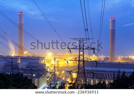 coal power station and night blue sky in hong kong - stock photo
