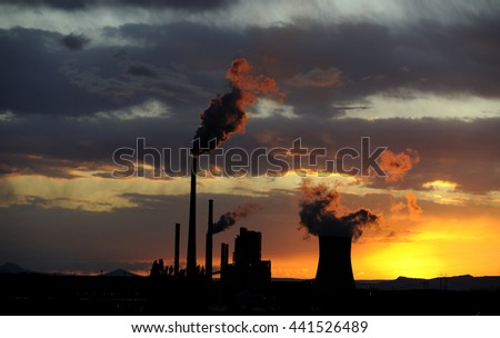 Coal power station in sunset with cloudy sky, industrial landscape - stock photo