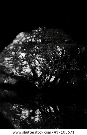 Coal reflection / A lump of coal reflected on a black background - stock photo