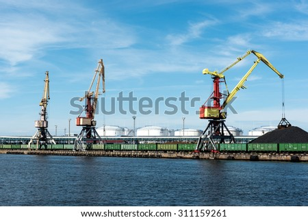 Coal ship terminal with cranes  - stock photo