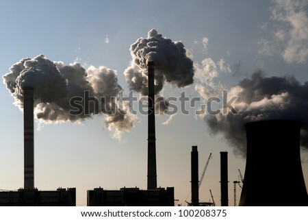 coal smoking power plant against the sun - stock photo