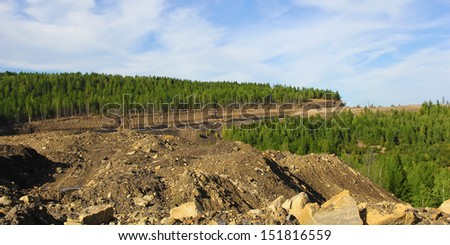 coal strip mine in South Yakutia against the blue sky - stock photo
