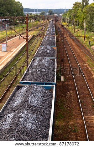 Coal train passing through the station - stock photo