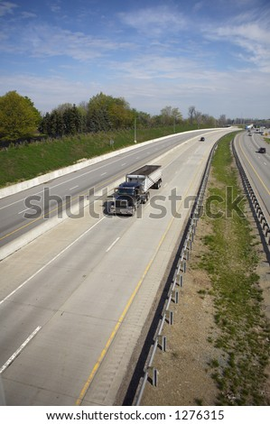 Coal Truck Hauler Wide View on the Highway - stock photo