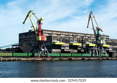 Coal warehouse and train loading cranes - stock photo
