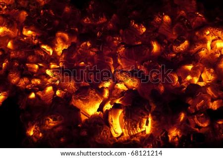 Coals burning flameless in fireplace - stock photo