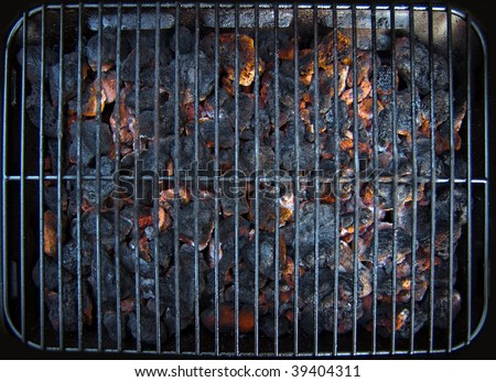 Coals burning ready for the barbecue - stock photo