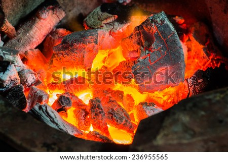 Coals in the fireplace - stock photo