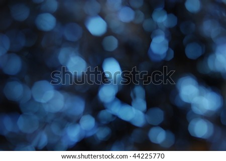 Coarse bokeh of blue lights. Horizontally framed shot. - stock photo