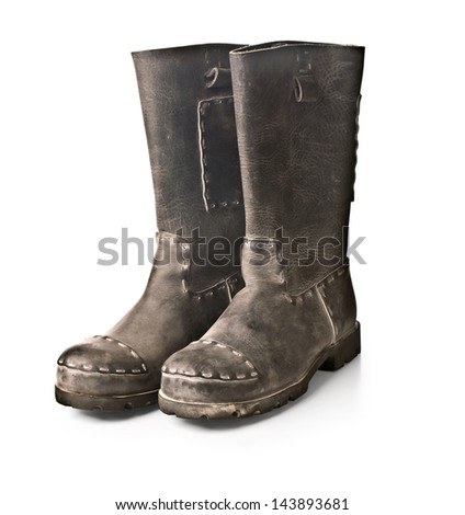 coarse men's boots against a light background - stock photo