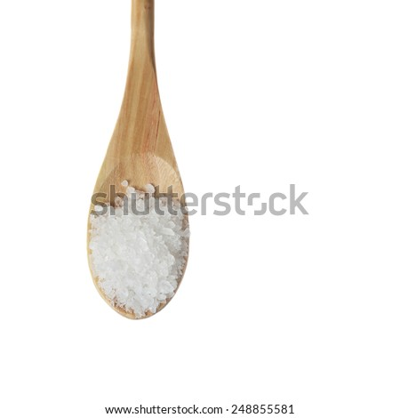 Coarse salt in wooden spoon isolated on white background with text copy space - for diet or cooking concept - stock photo