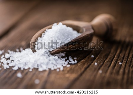 Coarse Salt (selective focus; close-up shot) on a dark vintage background - stock photo