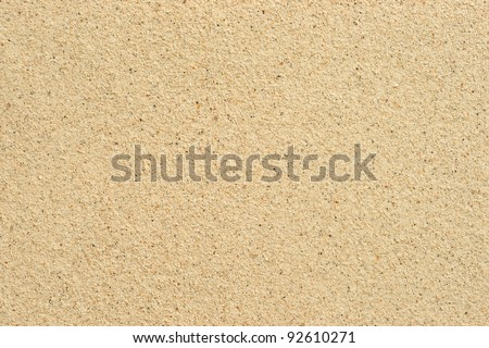 Coarse sand background texture. Macro of coarse sand grains. - stock photo