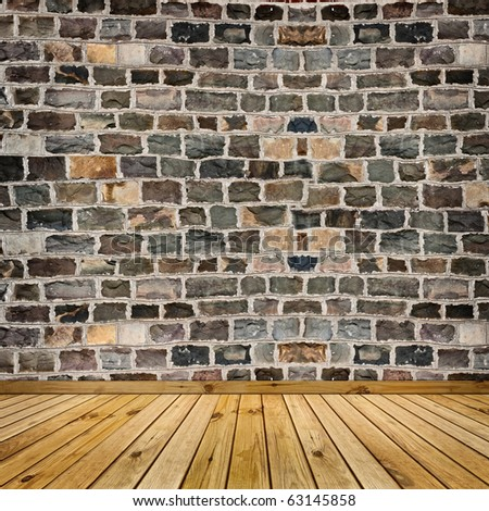coarse stone wall and the wooden floor - stock photo