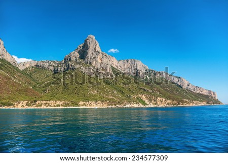 Coast and blue Mediterranean sea in Sardinia, Italy. View from the yacht - stock photo