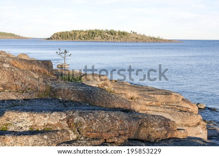 Coast and coastline at UNESCO High Coast Heritage, Sweden. Huge stones, rocks and cliffs along the coast. Isostasy close to one cm per year.  - stock photo