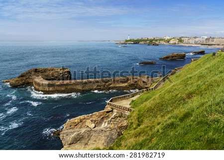 Coast and lighthouse of Biarritz, France - stock photo