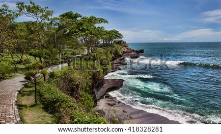 Coast at Uluwatu temple, Bali, Indonesia. The path by the ocean - stock photo