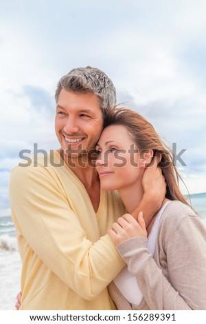 coast couple enjoying togetherness in autumn - stock photo
