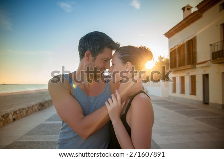 coast dreamers walking sunset - stock photo