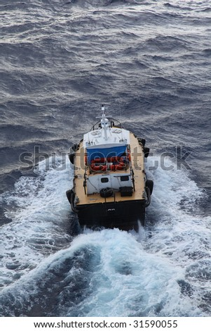 Coast guard boat in deep blue water - stock photo