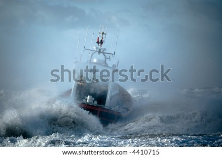 coast guard during storm in ocean - stock photo