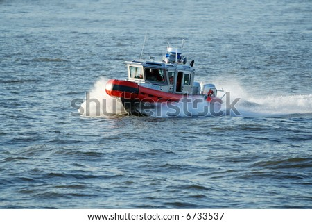 Coast Guard patrol boat rushing to the rescue. [ALL NAMES REMOVED] - stock photo