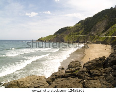 Coast line in spanish Deba city. rocks water and blue sky