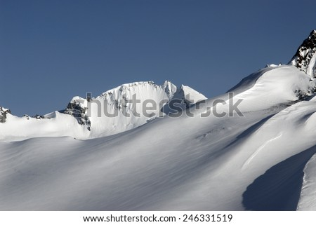 Coast Mountains, snowy peaks, rocks and slopes, British Columbia, Canada - stock photo