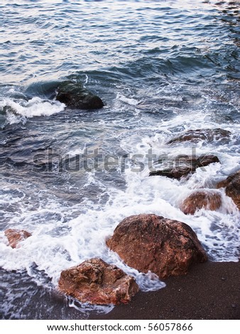 Coast of Black sea with a running wave - stock photo