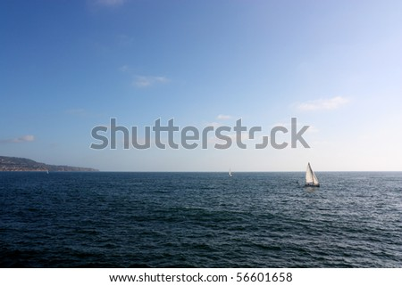 Coast of Redondo Beach with white yachts in ocean waters, California