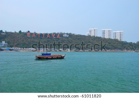 "Coast of the Pattaya beach in Thailand. billboard ""PATTAYA CITY"" in coast."