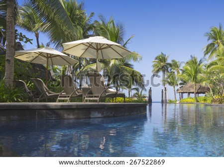 Coast of the tropical island. Beautiful vacation spot, suntan, restoration of forces, bathing and aquatics - stock photo
