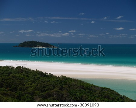 Coast of Whitsunday Island with white sand and cristal clear blue water, Great Barrier Reef - stock photo