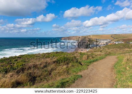 Coast path Cornwall Watergate Bay England UK Cornish north coast between Newquay and Padstow on a sunny blue sky day popular surfing beach - stock photo