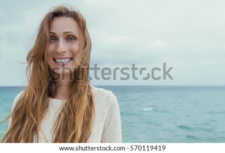 coast portrait of laughing woman